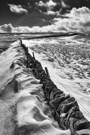 Drystone wall and snowdrifts in the North Pennines Area of Outstanding Natural Beauty (AONB) this winter photo