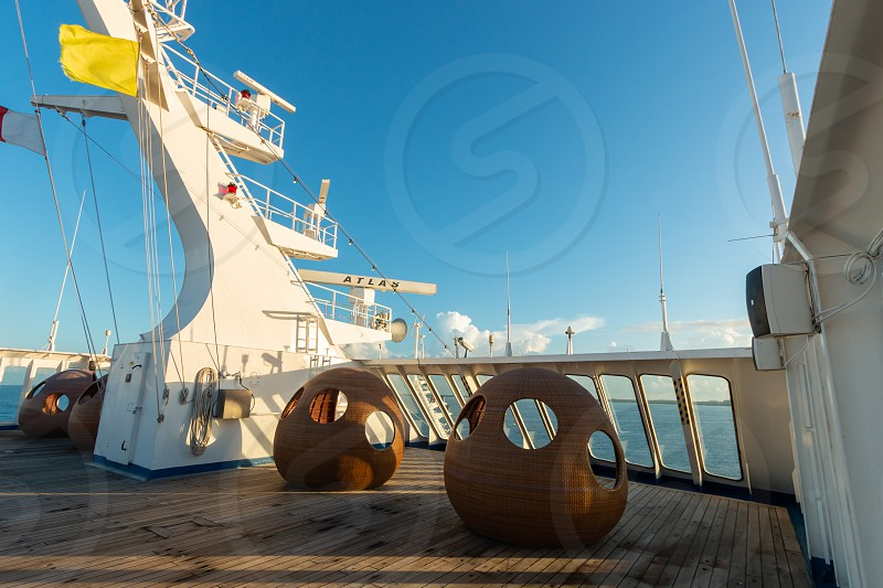 View of lounging pods in bow of cruise ship in the early morning photo