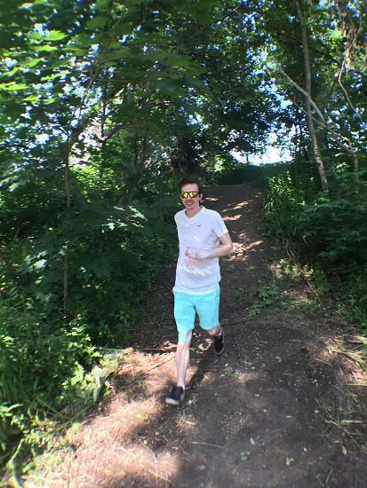 Action shot running hill down shades summer forest Unionville Ontario Markham fun photo