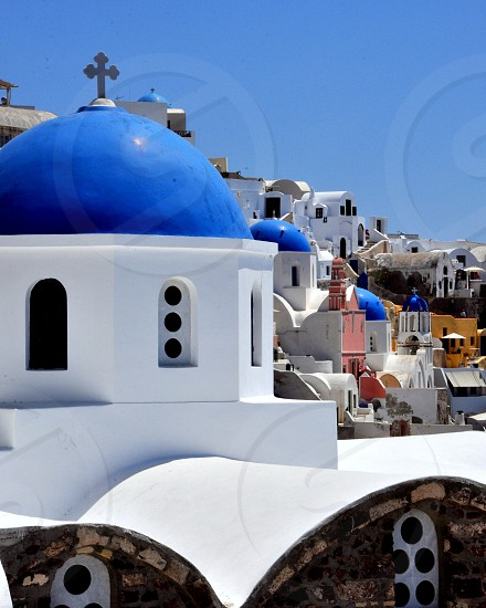 white and blue dome with cross on top building  photo