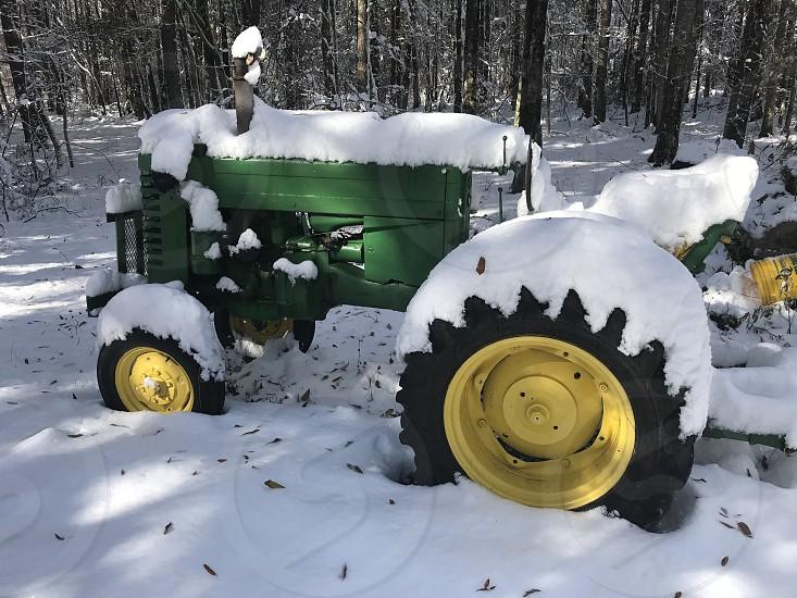 Snow winter cold tractor John Deere green yellow photo