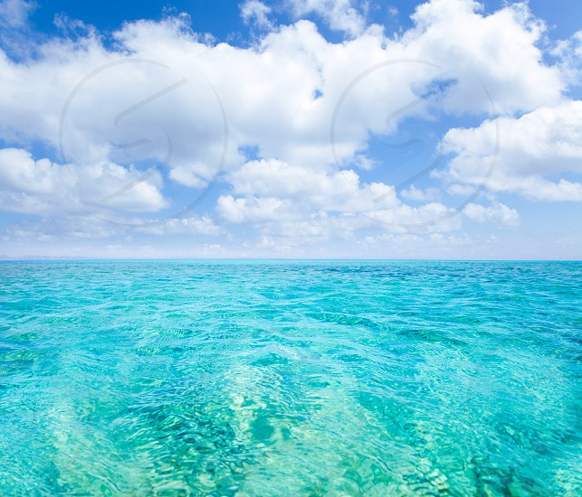 Belearic islands turquoise sea under summer blue sky in tropical beach photo