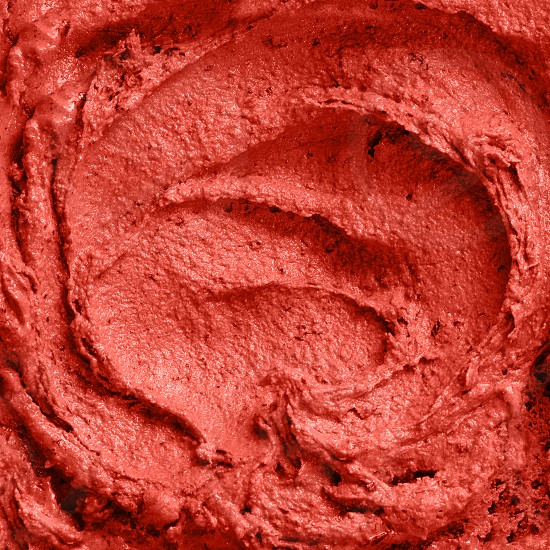 Delicious berry ice cream textured background in a trendy color of the year 2019 Living Coral Pantone. Close up. photo