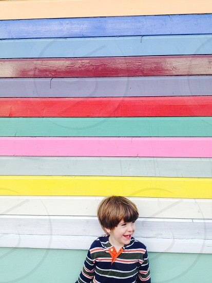 Boy child wall striped rainbow stripes Multi-Colour kid smiling smile photo