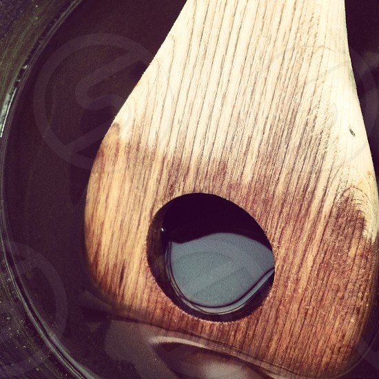 Wooden spoon stirring syrup photo