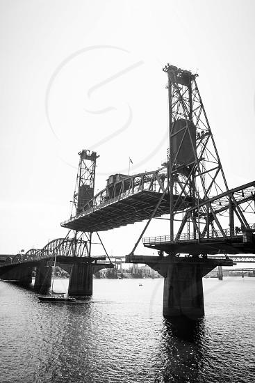 grayscale photo of lift bridge photo