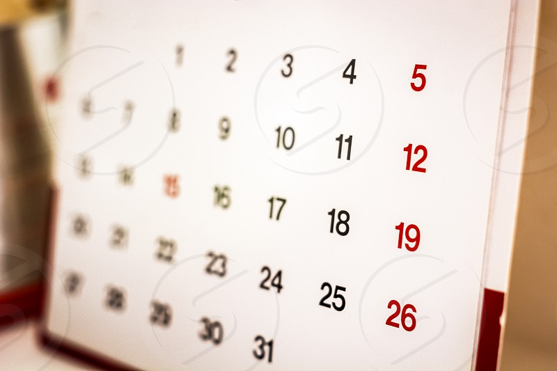 Closeup of numbers on calendar page. Business concept photo