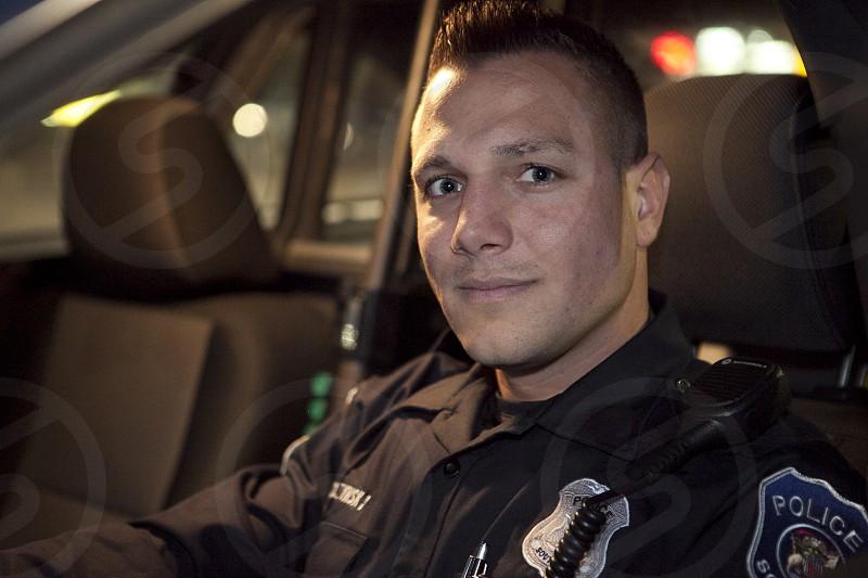 man wearing police uniform photo