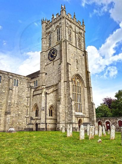 stone brick church with cl ock photo