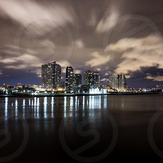 NYC'14 Night shot of Ling Island City from New York City. Long Exposure used for enhanced light capture along with stunning motion capture of the cloudy sky. #nightshot #nightphotography #newyorkcity #city #skyline #longexposure #huffpostsnap photo