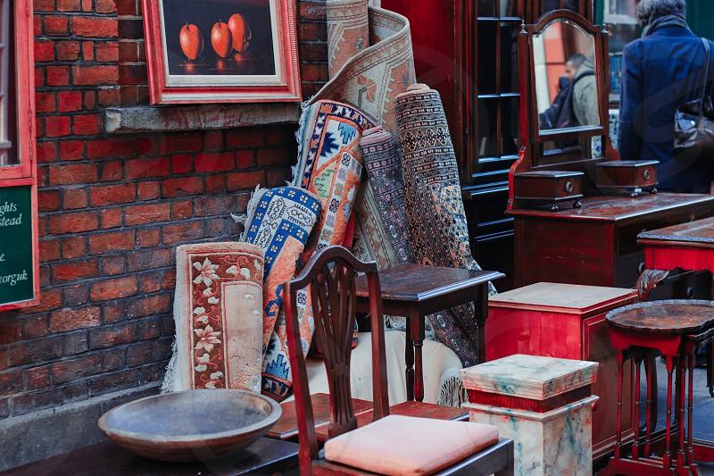 Old carpets in a London flea market photo