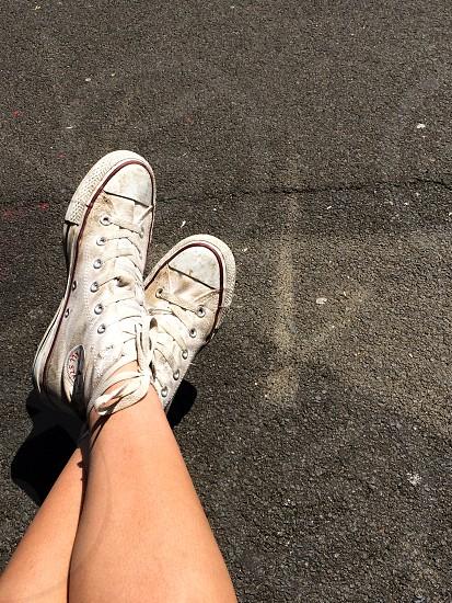 Converse on pavement photo