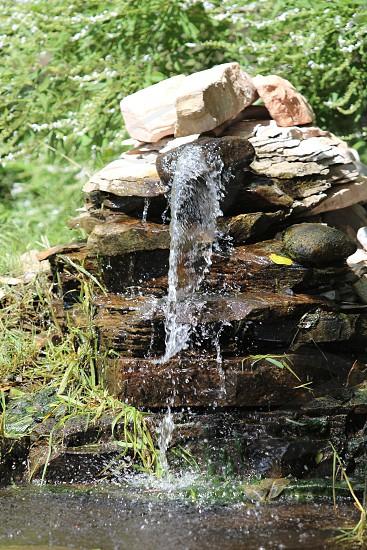 water pond rocks nature waterfall photo