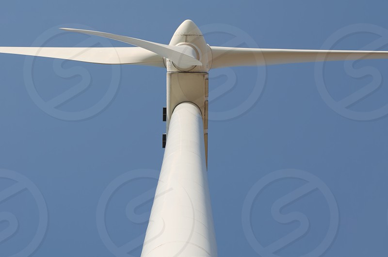 White Wind Turbine on Blue Sky Closeup photo
