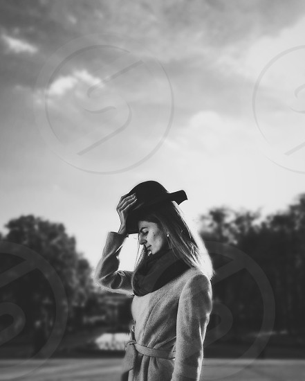 woman with hat and long coat photo