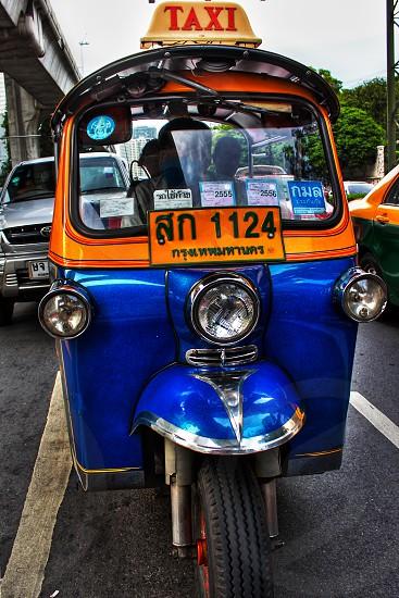 Tuk tuk colorful taxi tourist popular transportation in Bangkok Thailand photo