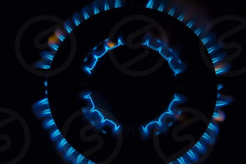 Gas burner flames - Closeup top view isolated on black background. photo