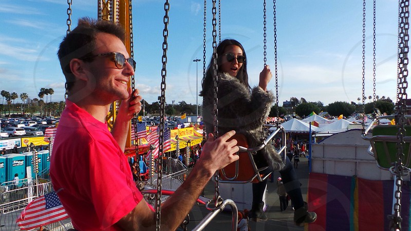people riding on flying carousel photo