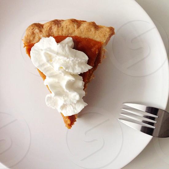 sliced pie on a white ceramic plate photo