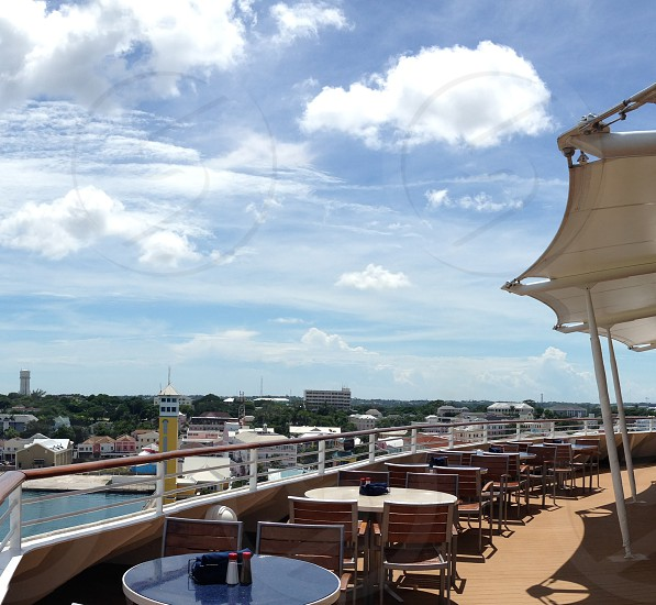 Cruise ship deck with tables and a view of the Bahamas photo