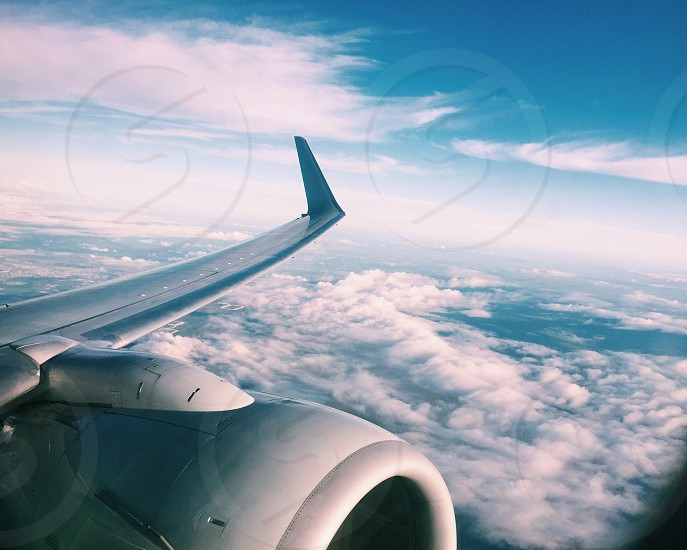 airplane wing and engine in the sky photo