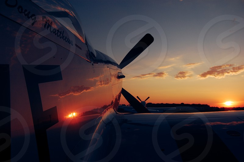 P-51 Mustang reflects a perfect sunset. photo