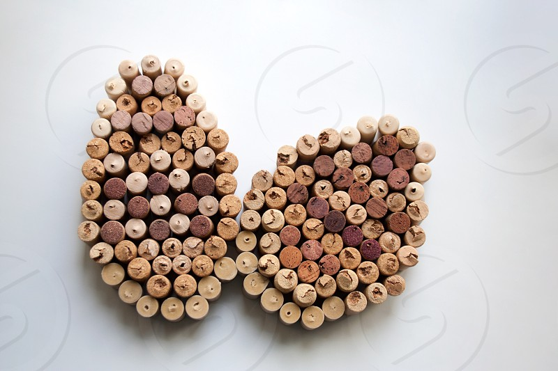 Wine corks Easter eggs abstract composition isolated on white background photo