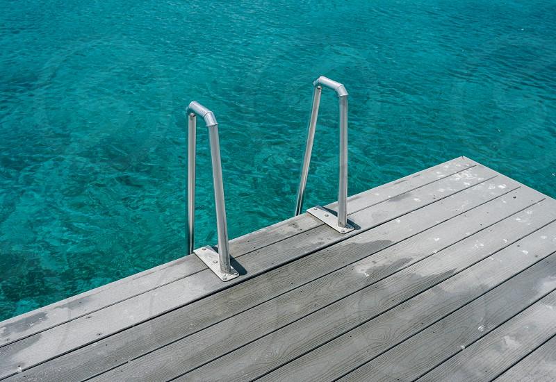 ocean teal sea water dock photo