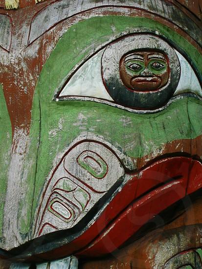 Green Totem Pole Frog Face Closeup photo