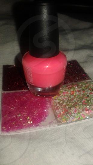 Pink nail polish with pink glitter specks. photo