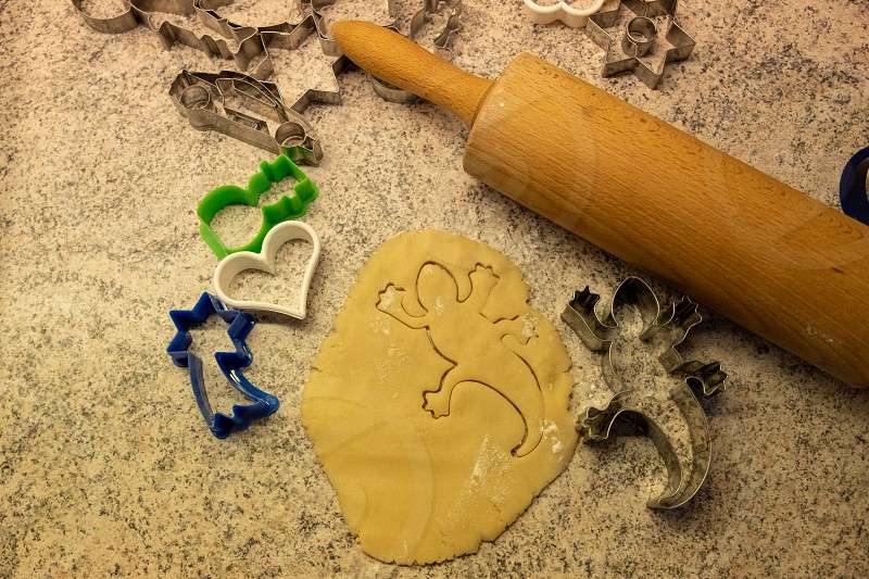 dough and cookie cutter with a kitchen roll an flour for baking cookies for christmas photo