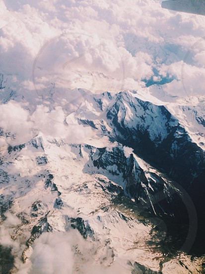 Alps . Mountains . Birdseye view . Snow . Clouds  photo