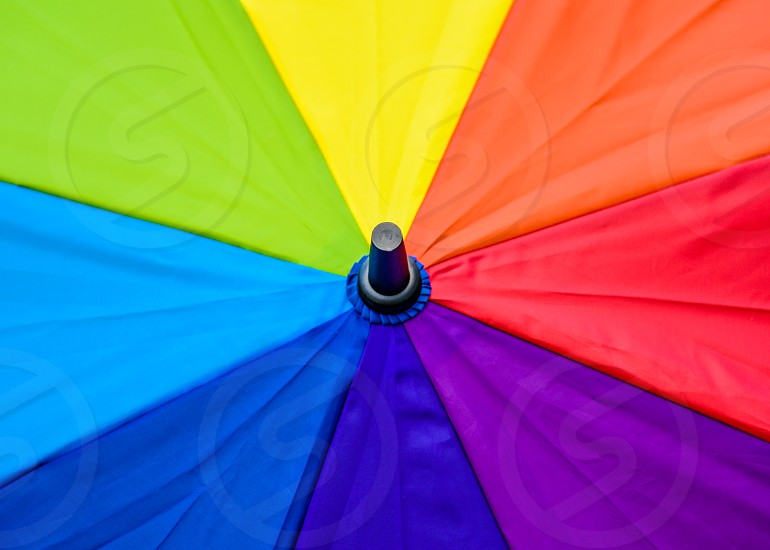 closeup photography of orange red purple blue green yellow umbrella photo