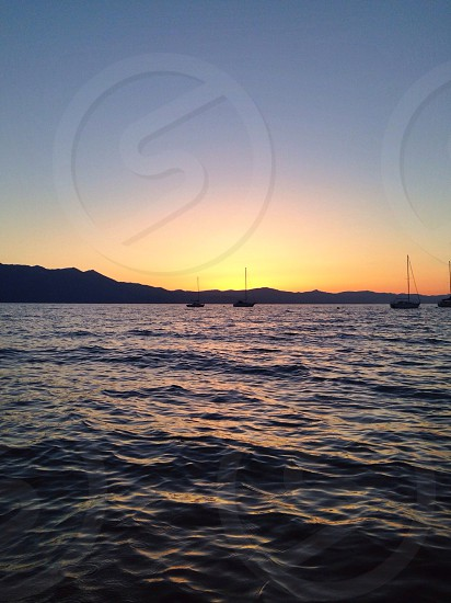 photo of sea under a sunset photo
