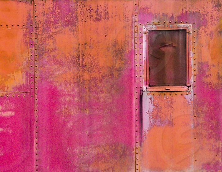 orange and pink metal sheet with a close window photo