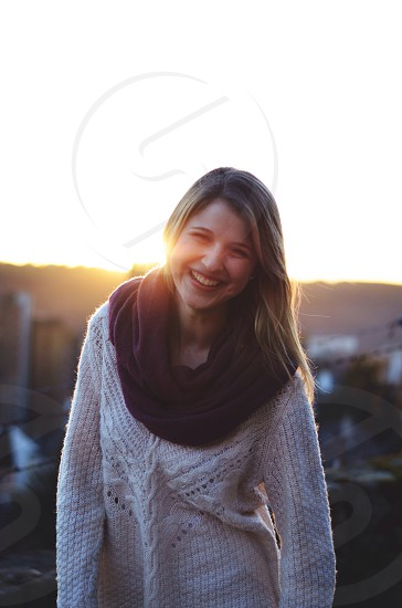 woman wearing white knitted sweater smiling photo