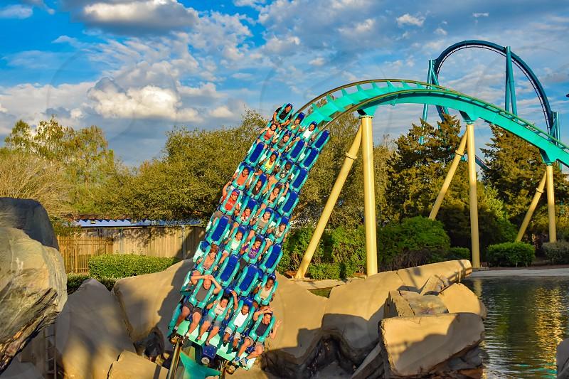 Orlando Florida. March 05 2019. People having fun Kraken rollercoaster at Seaworld Marine Theme Park (11) photo