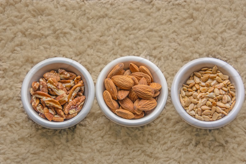 assorted nuts in bowls photo
