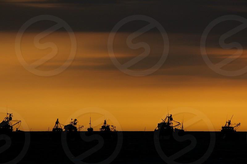 Sunset over the Pacific Zorritos Peru. photo