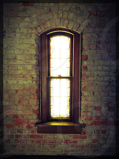 brown framed clear glass window photo
