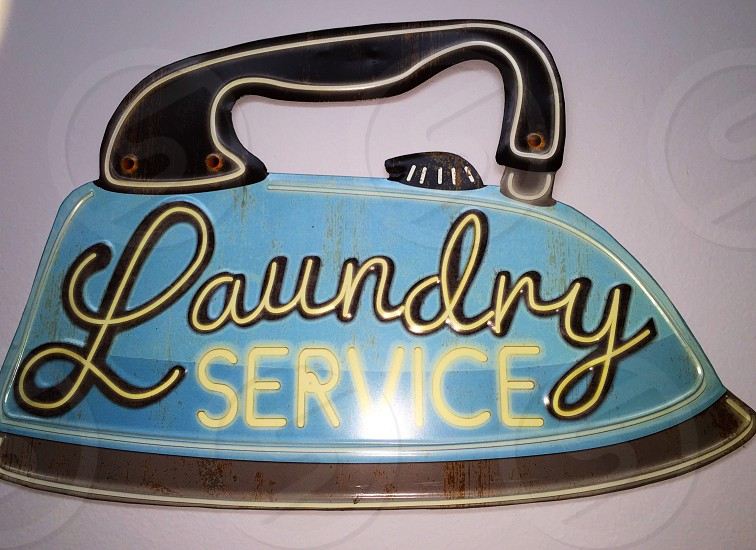 laundry service neon light iron photo