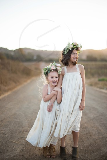 Flower girl girl happy nature outdoors children kids kid wedding flower crown flowers bridesmaid bride photo