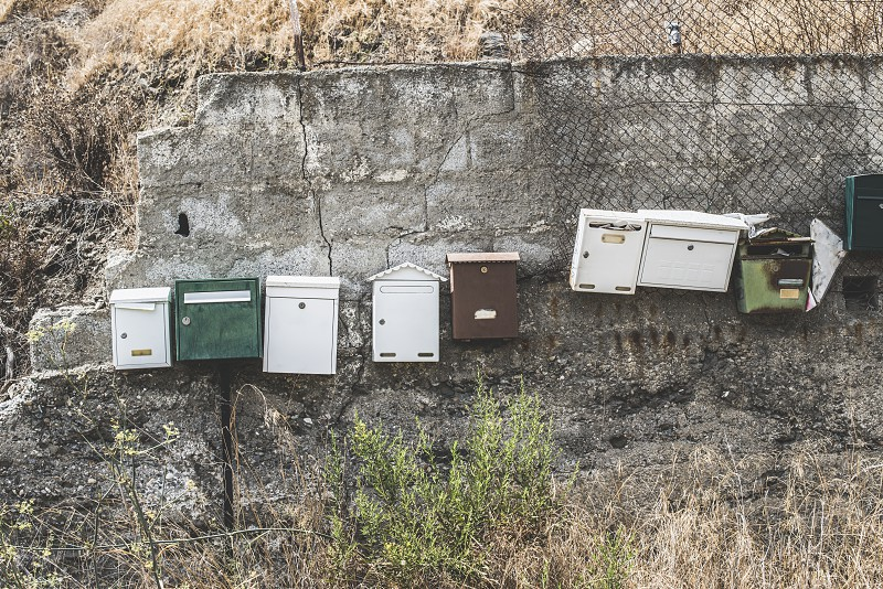 Various mailboxes. Different colors and shapes photo