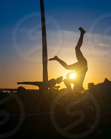 Some acro-yoga next to the beach for some of that beautiful summer time afternoon glow. photo