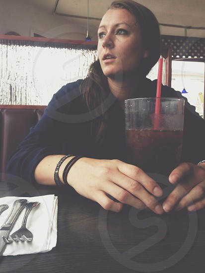 Portrait. Concerned looking away woman girl lady quiet generation x hands soda diner table  photo