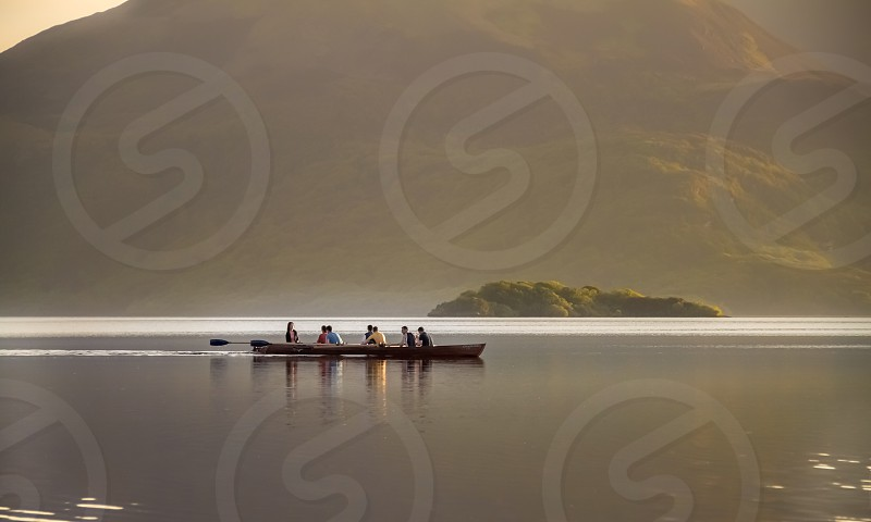 Boat lake rowing people sport active mountains sunset photo