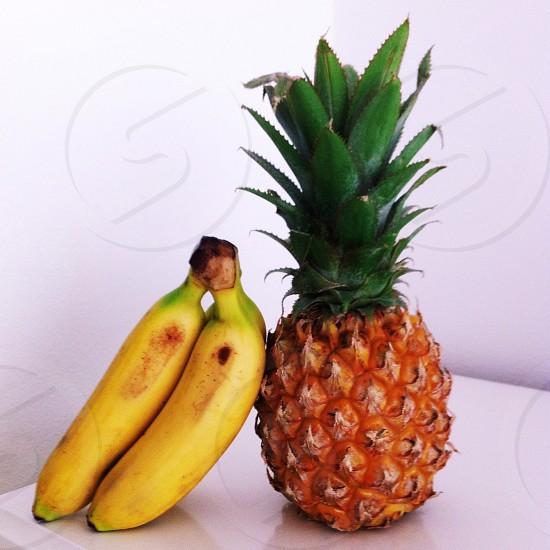 pineapple and 2 yellow bananas photo