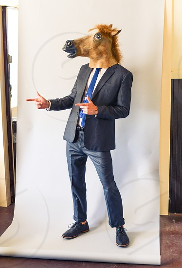 suit tie horse mask man photo
