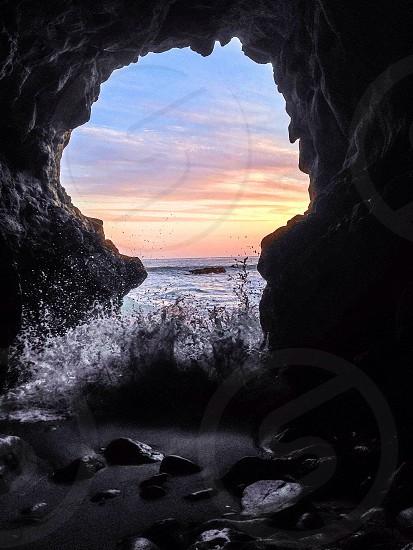 Cave nature ocean beach wave waves keyhole Malibu California pacific coast water sand rock rocks outdoors outside photo