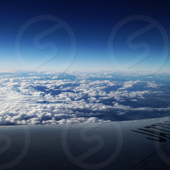 view of white clouds by the aircraft window photo